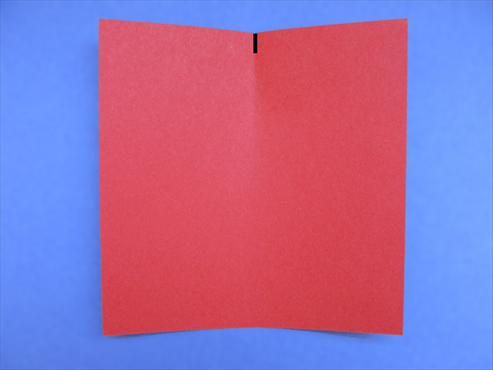 <p> Bring the right edge over to the left edge as if you were going to fold the paper in half. Do not crease it. Just pinch the edge to make a half way mark.</p>  <p> *Short sides on top and bottom for rectangle paper</p>   <p>  </p>