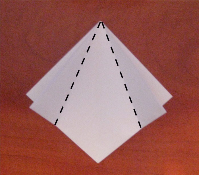 Make sure the open end of the paper is at the bottom.
