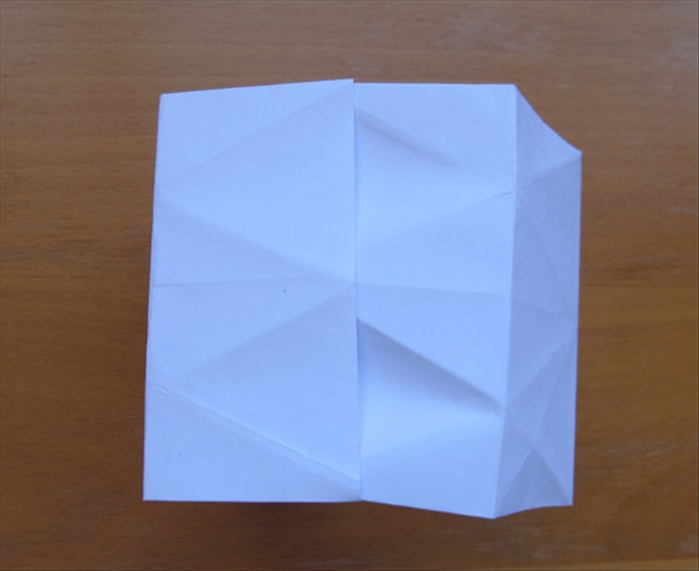 Flip over the paper to the other side Bring the ends together and insert one side into the pocket