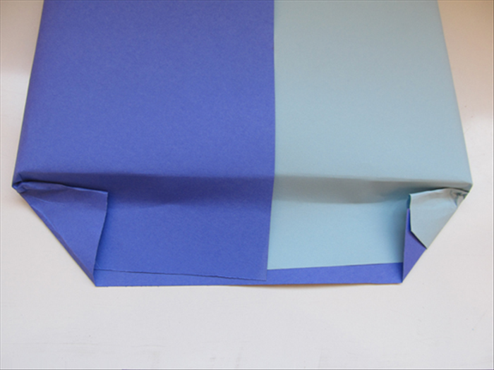 Fold the corners up to the present.