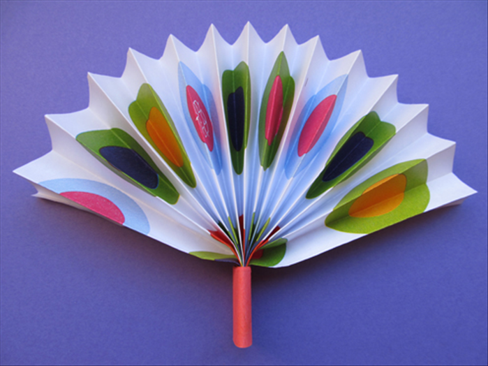 Pull down the ends of the folded paper.  Your fan is ready to cool you off!