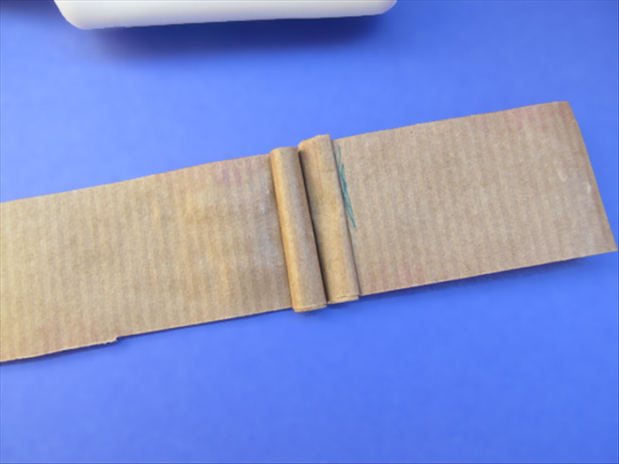 <p> Align and glue another roll next to the first and then flatten it.</p>  <p> &nbsp;</p>
