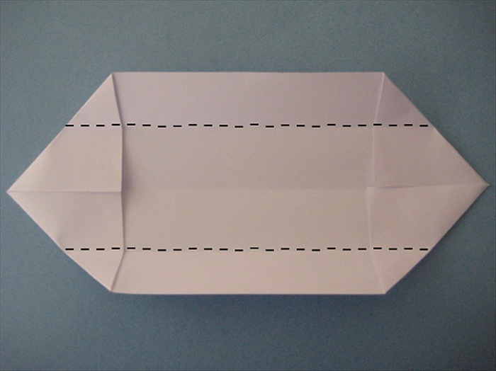 Fold the top and bottom edges to align with the center crease.