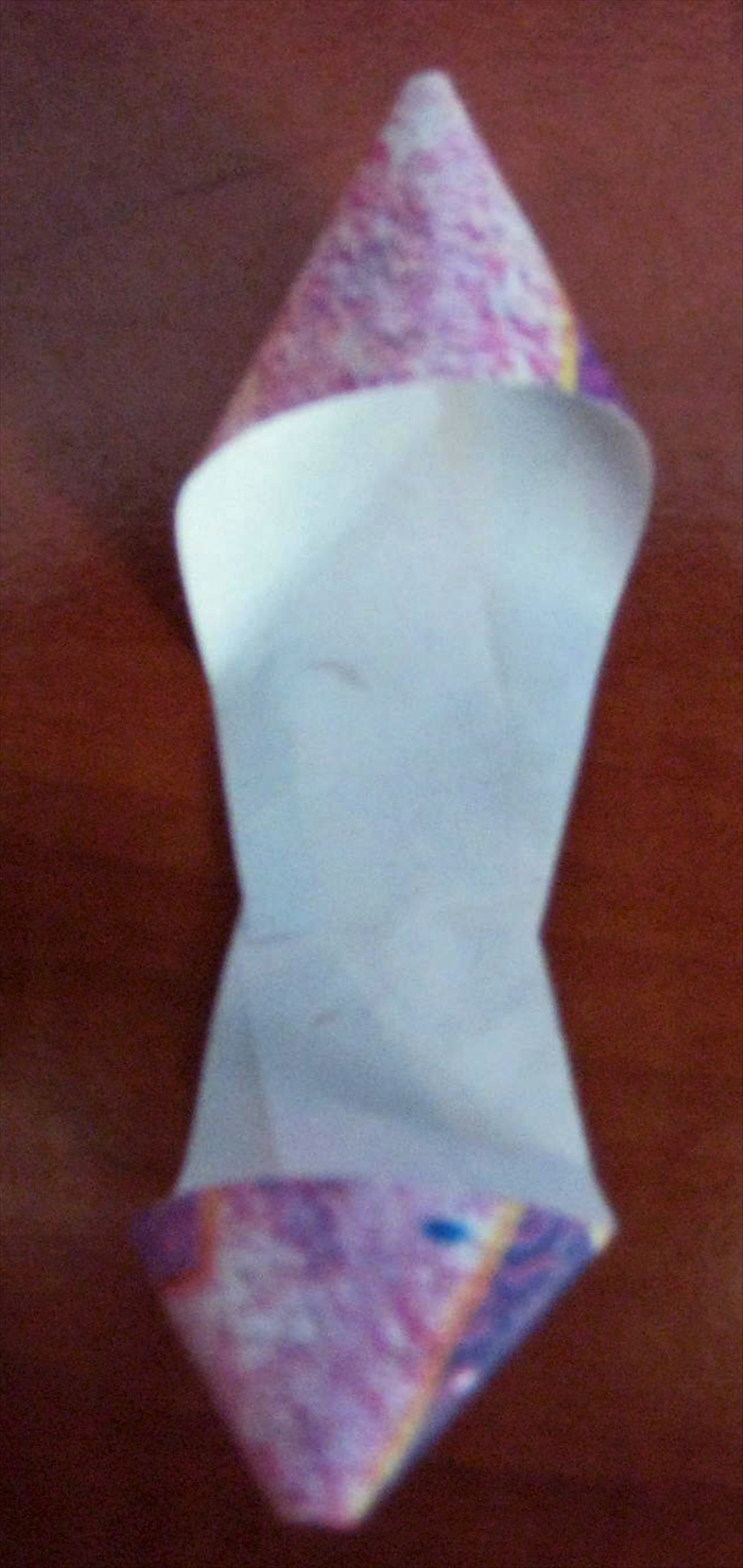 Turn the paper around,  repeat the directions but align the end of the paper to the end of the other loop.  Glue it in place