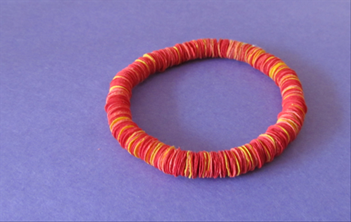 Materials: Scrap paper Hole puncher Elastic string for the bracelet or strong string for the  necklace Needle a small piece of corrugated cardboard