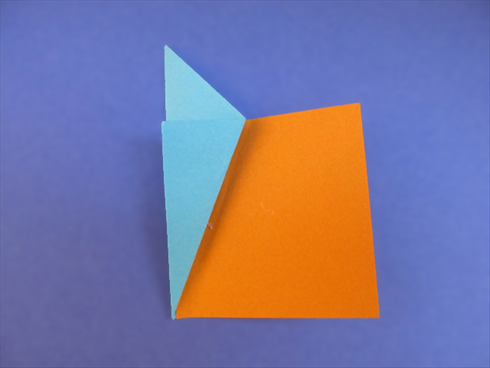 <p> Insert one of the 16 squares under the flap.</p>  <p> Slide it in until it is aligned with the inner fold.</p>  <p> Make sure the bottom edge of the square is aligned with the bottom point of the fold.</p>  <p> Lift the right side of the square and fold it over the edge of the flap.</p>  <p> &nbsp;</p>