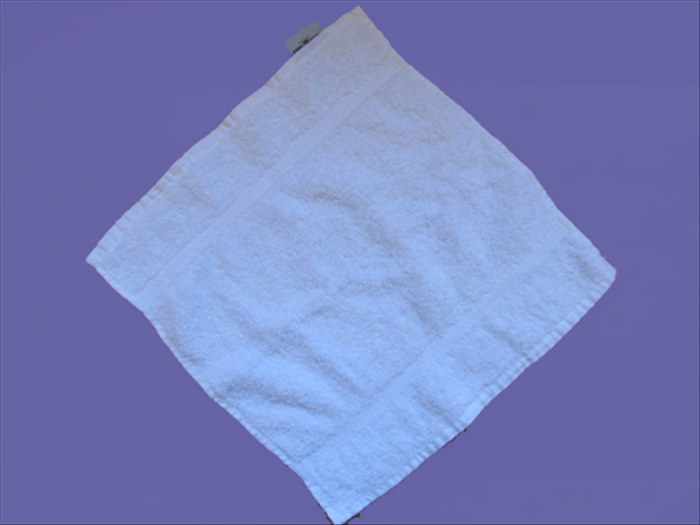Open the washcloth with the points at the top, bottom and sides