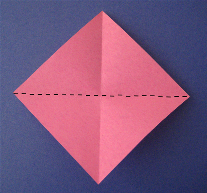 Rotate the paper and fold it diagonally in the opposite direction