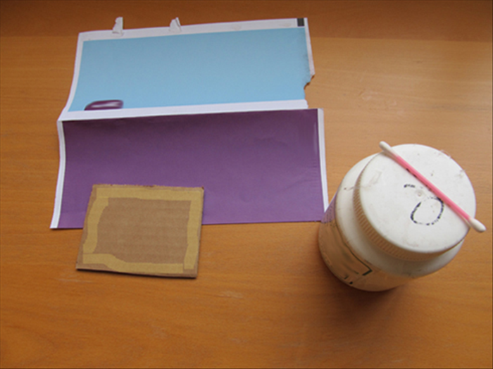 <p> Cut a piece of thick cardboard the size you want your name plaque to be. For this guide a 3 &amp;frac12; inches by 4 inches piece was used. Apply glue only around the edges of the cardboard . and glue a peice of pretty colored junk mail or magazine page to it.</p>