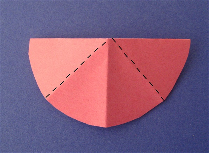 Fold the straight edges on top down to the center crease