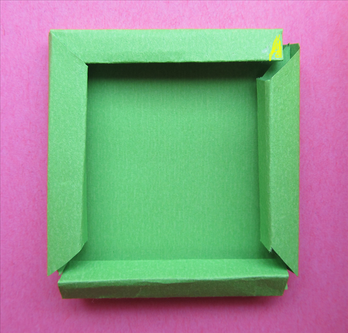 put glue on the tips of the straight edges and insert them under the slanted edges to form the frame - Diy Cardboard Picture Frame