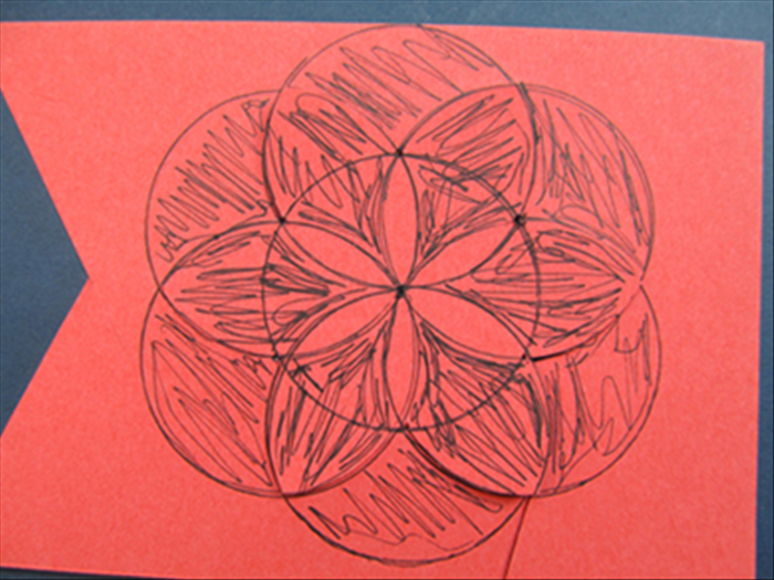 You can cut out the area around the center petal shapes for a thin flower or stamen. (cut out the area colored in black)