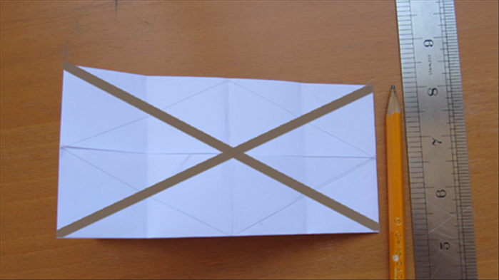 Draw 2 lines going across diagonally from the corners as shown Flip the paper over to the other side and repeat steps12 To 14 on the back