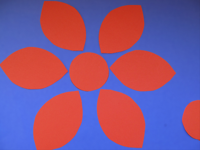 <p> Take the 6 petals and distribute them around one of the cut out circles.</p>   <p>  </p>