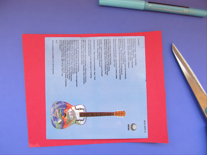 <p> Choose a colored paper for the game background.</p>  <p> Trace the outline of the square paper from the CD case and cut it out.</p>  <p>  </p>