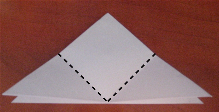 Fold the 2 bottom points up to top point.