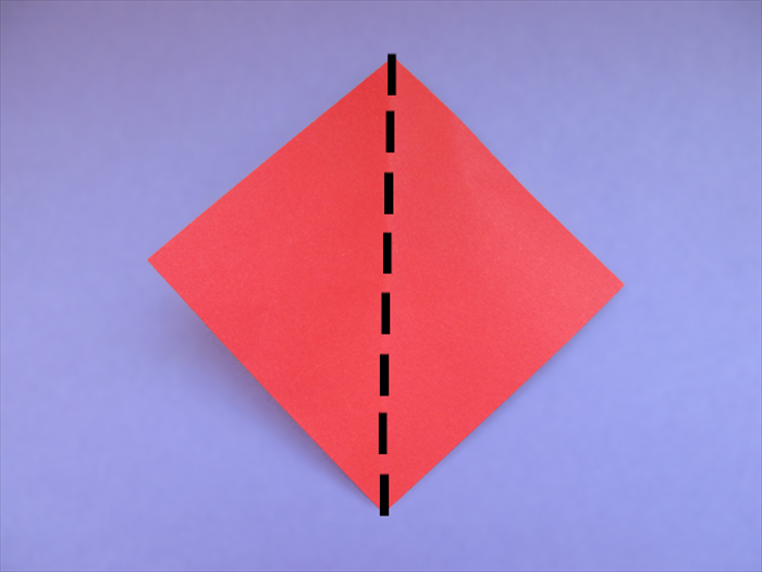 Hold the square piece of paper diagonally Bring the side points together to fold it in half