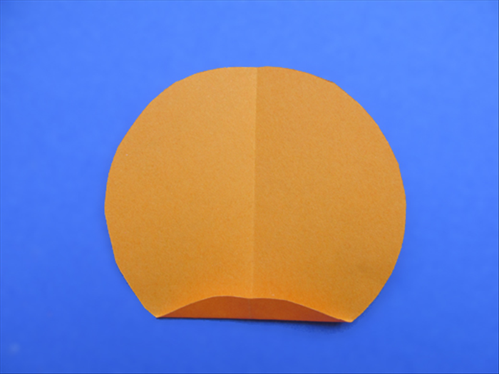 Rotate the circle so that the crease is vertical