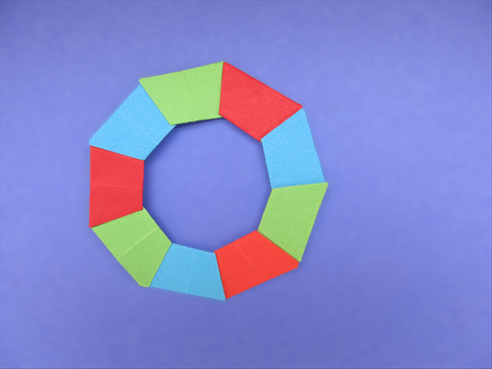 <p> Glue all the remaining pieces using the same color order.</p>  <p> Enjoy your origami wreath!</p>