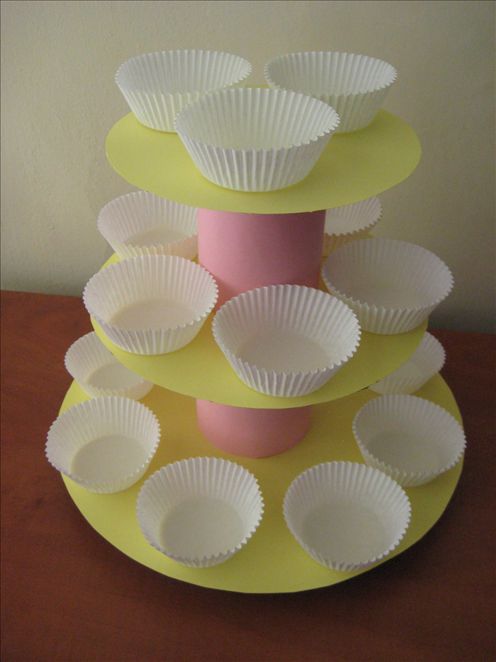 Materials: Cardboard Circular items for templates such as a large serving tray and dishes 2 full cans of food – the food provides weight and makes the tower stable Decorative or wrapping paper Pen, scissors, scotch tape, paper glue stick
