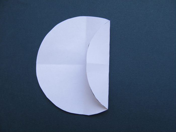 Fold the right side of the circle to the center. Unfold