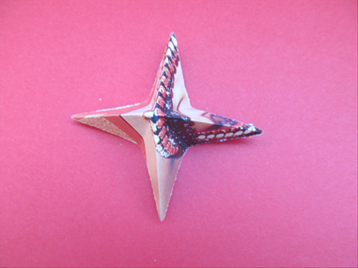 The result is a 4 pointed star.  *Notice that the other folds go inward.