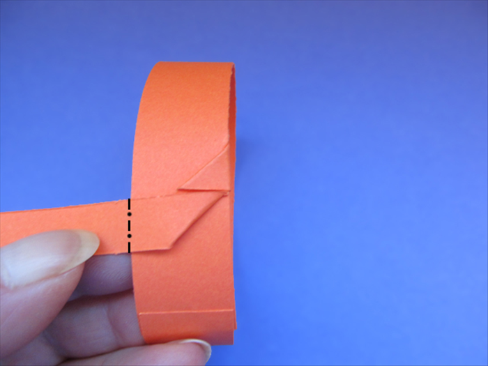 <p> Fold the strip backwards along the left edge of the band.</p>  <p> &nbsp;</p>