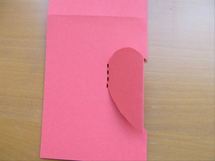 Fold the half - heart  shape to the left along the area you did not cut.