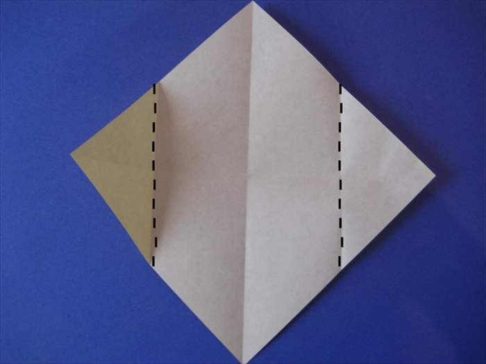 Fold the side points to the center crease
