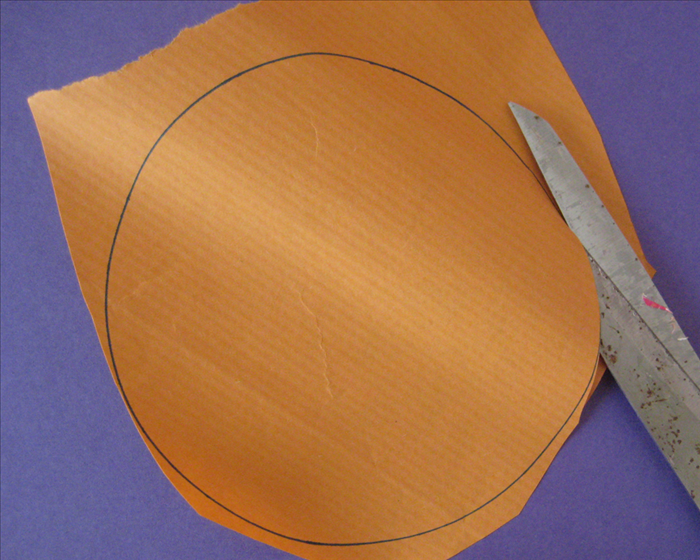 <p> Cut out the circles</p>