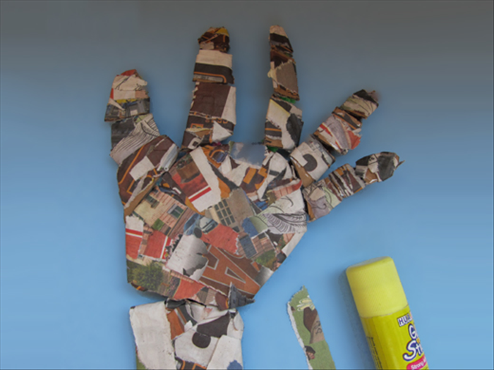 Rip strips of newspaper. Coat one side of the papers with glue and wrap them around the hand and fingers. *Wrap each cut part of the fingers separately so they will be able to move.