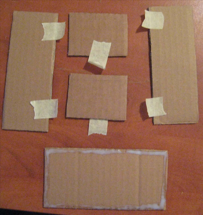 <p> Spread glue around the edges of the largest rectangle. Put masking tape on all the other rectangles. Put glue on the 2 shortest edges of the 2 smallest rectangles. Place the long edges of the taped rectangles onto the glue. Align all the edges and use the tape to hold them in place until the glue dries completely.</p>
