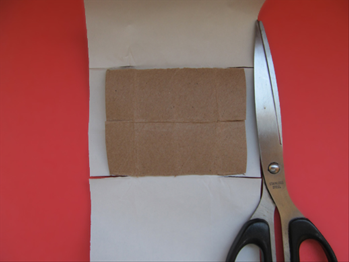 Use the slits in the box as a guide where to cut slits in the paper