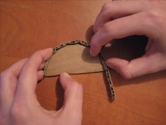 <p> Use a thin cardboard strip to measure the rounded top. Cut off the extra part.</p>