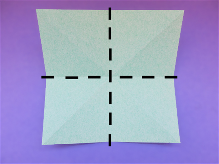 <p> Flip the paper over to the back side.</p>  <p> Fold the top and bottom edges together to fold it in half. Unfold.</p>   <p> Fold the side edges together to fold it in half. Unfold.</p>   <p>  </p>