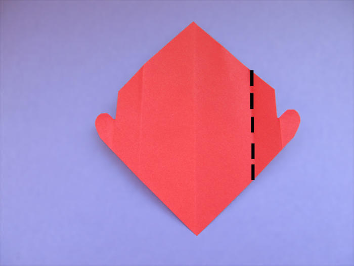 Unfold the paper Fold the crease of the half heart shape to align with the center crease