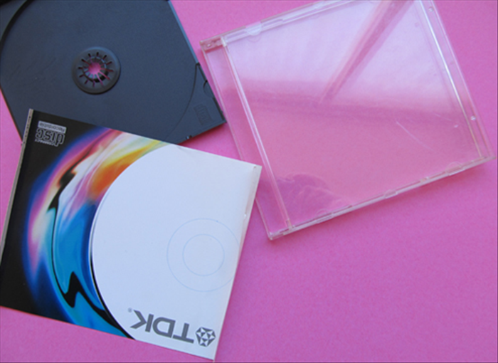 <p> Remove the paper and plastic that holds the CD.</p>  <p>  </p>
