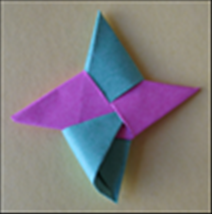 <p> and tuck it into the flap as shown in the picture. Push it in all the way and your throwing star is ready!</p>