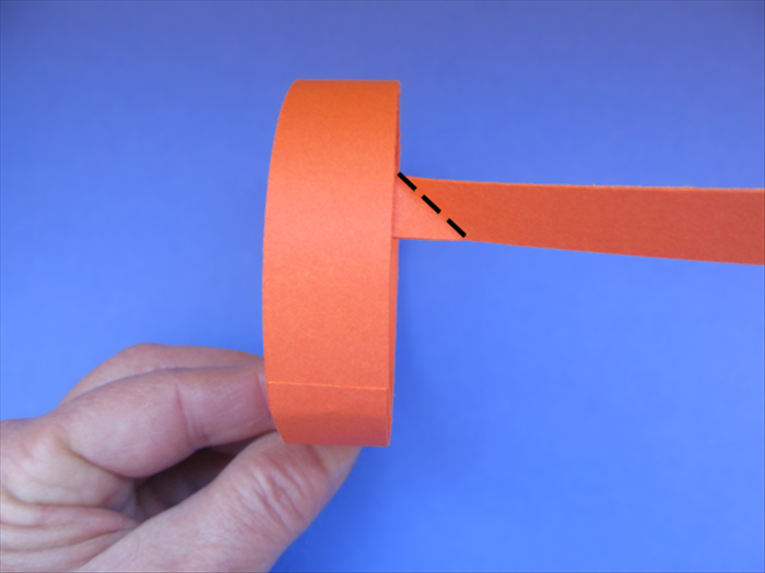<p> Turn the band so that the thin strip is on the right side.</p>  <p> Fold the top edge of the thin strip down to align with the right side of the band.</p>  <p> &nbsp;</p>