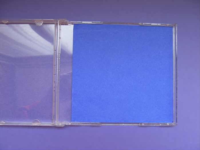 Check if the cut square fits nicely into the CD case. This will be the background paper for the game.