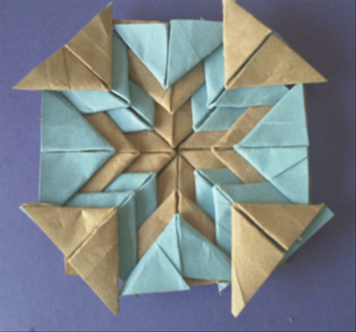 Last one. Glue 4 brown triangle on corners