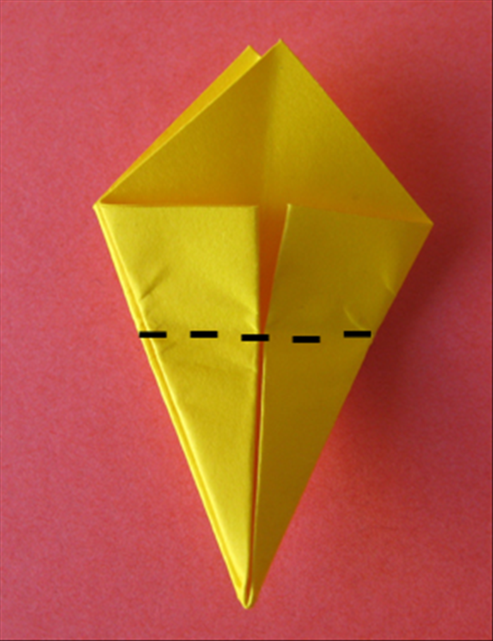 Bring the bottom point up to the top to fold the paper in half.