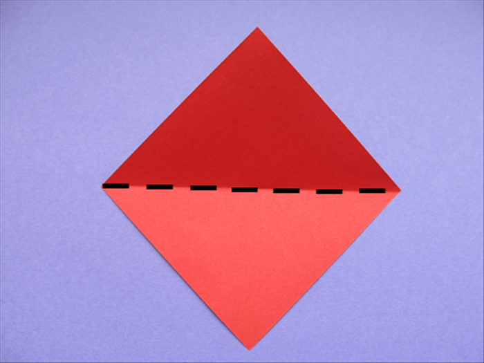 Place the paper with the points at the top, bottom and sides.  Bring the bottom point up to the top to fold it in half Crease and unfold