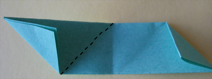 <p> Take the other paper and fold the left side down at the center crease.</p>