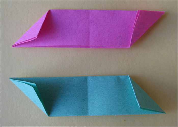 <p> You should have the 2 peices folded in the opposite directions as in the picture.</p>