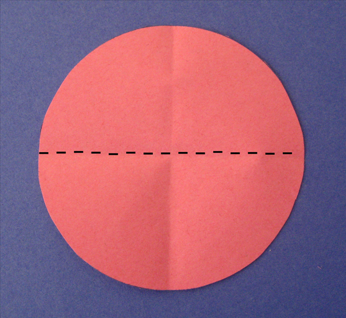 Rotate the circle and align the crease you just made to fold it in half again
