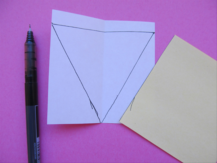 <p> Use the straight edge to connect the dots with a line.</p>  <p> Cut out the triangle</p>  <p>  </p>