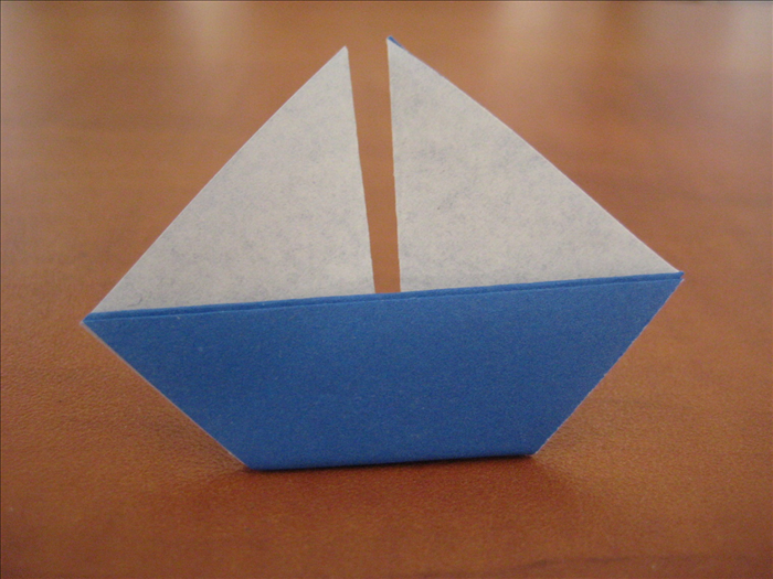 Turn the model over and your origami sailboat is finished!
