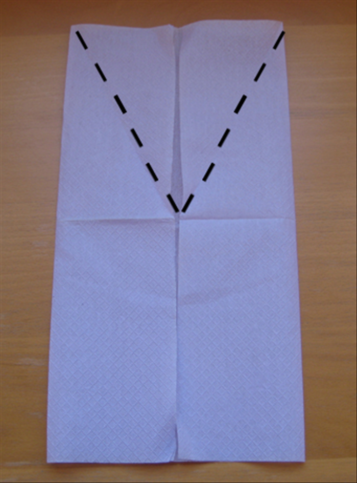 Fold the flaps you just made at an angle from the center down to the sides as shown in the picture.