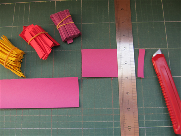 <p> Cut strips of paper 3 inches wide and then cut them into 3 / 4 inch strips.</p>  <p> &nbsp;</p>